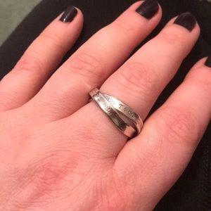 Interlinked silver metal rings